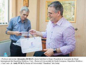 Profesorul universitar Alerxandru Burian, din Republica Moldova, și rectorul Andy Pușcă